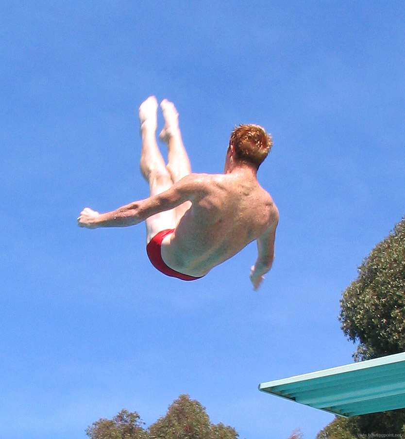 Utah diver in the air: Utah senior Andrew Jones practicing off the high dive between rounds.